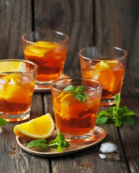 Glass of aperol with ice, orange and mint, selective focus